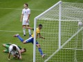 Leandro Damiao of Brazil scores a goal during their men's first round Group C preliminary soccer match against New Zealand at the London 2012 Olympic Games in Newcastle