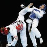 LONDRES. La taekwondista mexicana Jannet Alegría (rojo) durante su combate contra la jordana Raya Hatahet, correspondiente a la categoria de -49 kilos de la fase preliminar del torneo de taekwondo de los Juegos Olímpicos de Londres 2012. Foto: EFE